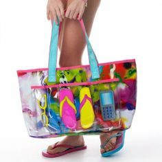 Marble Print Beach Bag This tote is the ultimate in beach bags! A hip oil spill pattern with 4 clear outer pockets for all your beach gear. Bold graphics on each is super cute and keeps it simple to stay organized. Shades? Check. Flips? Check. Celly? Check. Bikini? Check! Leaving the inner compartment plenty of extra room for your towel, radio, snorkel gear and snacks!  #tweengifts