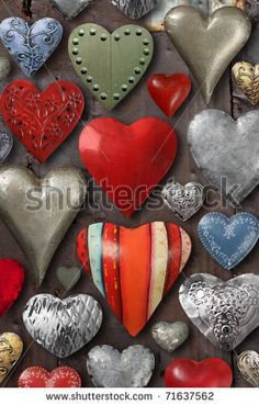heart made stuff | Background of heart-shaped things made of metal and steel. - stock ...