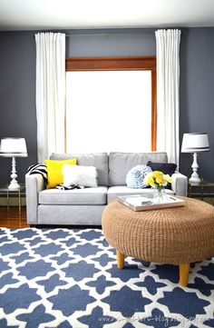 Den with wood trim and hardwood floors. Walls painted blue-grey, graphic blue rug and light grey furniture with pops of yellow too. Love love love the rug Le Living, Living Room Grey, Home Living Room, Living Room Decor, Small Living, Room Paint Colors, Paint Colors For Living Room, Color Walls, Home Design