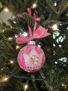 Fancy Nancy inspired....tulle inside the ornament? Decorations on the outside?  Cute