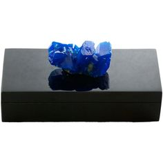 This felt lined box is an absolute treat! Lacquered in a sharp black color and adorned with a snazzy blue mineral, it makes for a dramatic accessory on your table top!  Times Two Design products are made with natural stones. Variations in the stone colors and sizes should be expected and are not considered defects. Please call for details.