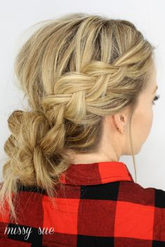 Your messy bun will stand out in a crowd when you add a pair of loose Dutch braids to the style.