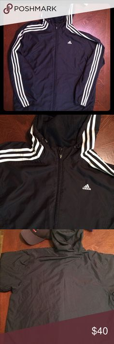 "Black and white striped Adidas windbreaker jacket Small spot on right breast, two small holes on the back of the right forearm. The holes are only on the top layer, not the lining so skin is not exposed! Men's size Large.27.5"" long, 25.5"" from armpit to armpit ,22.5"" from armpit to end of sleeve. Smoke free home! Adidas Jackets & Coats Windbreakers"