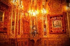 The Amber Room, outside of St. Petersburg, Russia. Large amber panels were gifted to Peter the Great in 1717. Inherited through imperial succession, Catherine the Great began construction in the Hermitage Palace to rival Versailles, completed in 1770.