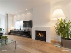 Terrific Free rock Fireplace Remodel Concepts White sheet rock fireplace with ledge, light wood floors Linear Fireplace, Home Fireplace, Fireplace Remodel, Modern Fireplace, Fireplace Surrounds, Home Living Room, Living Room Designs, Living Spaces, Mantel Styling