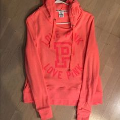 """Victoria's Secret hoodie Victoria's Secret pink hoodie sweatshirt. A pinky orange in color. """"LOVE PINK"""" printed on front. Nothing is on the back. Size small. Worn once. In excellent condition. I ship next day Victoria's Secret Tops Sweatshirts & Hoodies"""