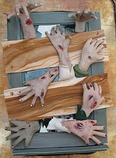 Make fake window in my carport haunted house using a frame and fake hands...