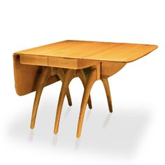 "A little-known fact about Butterfly Drop-Leaf Dining Table Extension Table is that the ""butterfly"" in the name refers to the small swing-away piece used to support the drop-leaf. Designed in 1949 -originally without the butterfly – this table is perhaps the most instantly-recognized item in the entire line of solid birch wood Heywood-Wakefield furniture."