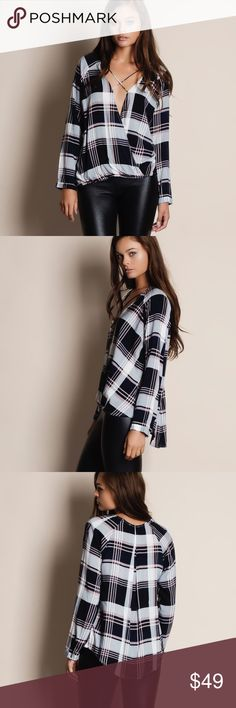 """Cross Front Long Sleeve Plaid Top Cross front long sleeve plaid top. Available in black and plum. This listing is for the BLACK. This is an ACTUAL PIC of the item - all photography done personally by me. Model is 5'9"""", 32""""-24""""-36"""" wearing the size small. NO TRADES DO NOT BOTHER ASKING. PRICE FIRM. Bare Anthology Tops Blouses"""