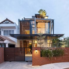 Aamer Architects have designed the 'Railway House', a semi-detached home in Singapore