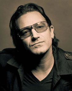 Bono (singer/activist).  I find it insufferable to hear some people say how insufferable he can be!  I'd put up with him for one meal.  He'll never be a cliché to me.  I could help him take a stand against poverty.  Or maybe sit in for Larry [Mullens Jr] on drums, should something happen to him!