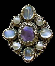 ALICE SCOTT (flourished 1900-1920) Arts & Crafts Brooch Silver, sapphire, moonstone & pearl Length: 4.3 cm  Width 3.7cm  (1.7 x 1.5 in)  Signed verso: 'AS' monogram  English. Circa 1910
