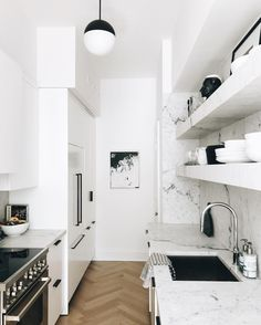 black and white marble kitchen with open shelving