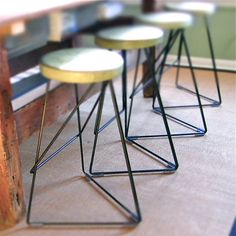 I really like the modern design of these concrete and steel stools. :: Etsy, GretadeParry