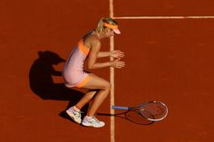 Maria Sharapova Photos: 2014 French Open - Day Fourteen. Maria Sharapova of Russia celebrates match point during her women's singles final match against Simona Halep of Romania on day fourteen of the French Open at Roland Garros on June 7, 2014 in Paris, France.