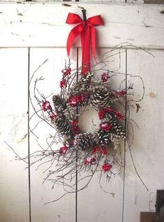 simple to make wreath - gather twigs from outside, pine cones and berries from the craft store