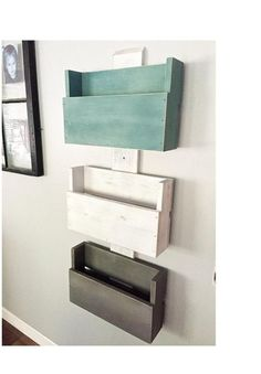 "This hanging wall storage unit is perfect for organizing homework, mail, bathroom accessories and toys. It is made of wood and measures 47"" h x 17.5"" w x 5.25"" d. The boxes measure 17.5""w x 11""t x 4.5"" deep. The inside measurements of each box are 16""w x 3"" deep. The bins are painted turquoise/aqua, white and gray. They are all distressed for a more rustic look. The 3 large bins will make organization easy and they look great too!135.0"