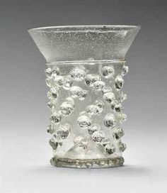 A MEDIEVAL GLASS BEAKER (NUPPENBECHER) | LATE 13TH OR 14TH CENTURY, GERMANY OR SWITZERLAND | Clocks, Marine Chronometers & Barometers Auction | beakers, All other categories of objects | Christie's