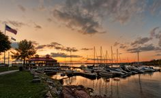 A view of the setting sun as it dips below the horizon at Lake Champlain in Burlington, Vermont.