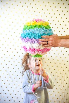 Have fun creating this DIY Pinata Easter Egg for a kid friendly Easter craft with your kids! This is a great DIY home tutorial or even a fun classroom activity.