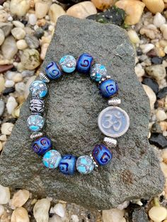 Excited to share this item from my #etsy shop: Om Bracelet. Women's Bracelet. Men's Bracelet. Zen Yoga. Sanskrit. Bohemian.Boho chic #no #unisexadults #bohohippie #blue #silver #ombracelet #mediationbracelet #yogabracelet #yogajewelry Bracelet Men, Yoga Bracelet, Beaded Bracelets, Hippie Boho, Bohemian, Zen Yoga, Yoga Jewelry, Sanskrit, Boho Chic