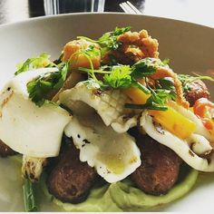 our calamari on fried gnocchi with an avocado and lemon dressing. Olive Restaurant http://www.oliverestaurant.co.nz/