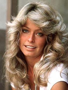 Farrah Fawcett hair...gotta do it for the 70's look!