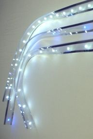 Cuttable LED light strips.  We are using a product called LEDhesive which is cuttable like these.  We are using them to light the display areas with glass doors.  It is unbelievable how warm this light is and it does not glare at all in the low output range.