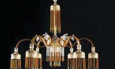 This #classic_chandelier named Iris it's a new creation in classical style of Aiardini master team. Entirely handmade in brass, flowers in crystal and beds in glass. Available in more version, size and finishing metal colors also on measure without limit of size. For price and more contact us by mail: info@aiardini.it.