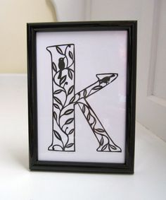 The letter K, initial paper cutting by Ingrid Lavoie Creative Shop on Etsy.