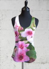 Floral Racerback: What a beautiful product! Our lightweight printed racerback top effortlessly blends style, comfort, and performance. Ideal for daily yoga sessions, weekend getaways, or lazy day lounge-wear, this top is perfect for layering with all your wardrobe favorites.