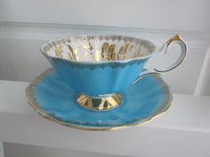 Queen Anne bone china turquoise tea cup & saucer, Queen anne tea cup with gold gilt. blue tea cup and saucer