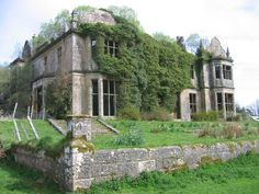 The decaying Poltalloch House - Built in 1853, this once grand Scottish estate fell into ruins in the 1950s when the owners dismantled the roof to avoid paying heavy taxes. Today its walls stand amongst brambles and vines, ravished by the elements as well as nature -- yet it still retains a quiet dignity. Photo from Casa Vogue, a supplement from the Oct '07 issue of Italian Vogue