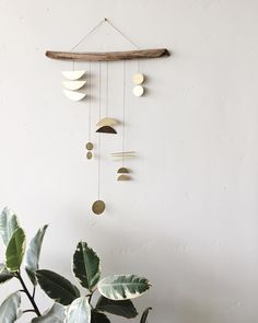 """Sarah Goddard Perez (@electricsuncreatives) on Instagram: """"A piece that represents my current season; a little scattered, but a whole lot more sure of myself.…"""" Gold hanging geometric mobile"""