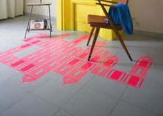 Sticker(s) over tiles on the floor (and partly under a big rug)