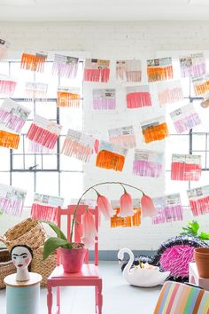 Love this colorful DIY newspaper garland!