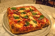 Ops in Bushwick is a sit-down pizza restaurant in Bushwick specializing in sourdough crust; Brooklyn Pizza Crew is a classic NYC slice joint in Crown Heights