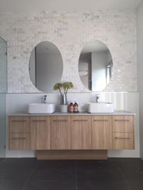 Hamptons style bathroom, styled very minimal letting the feature timber vanity and amazing oval mirrors. Another picture from a display we did for @ausmarhomes #interiordesign #scattercushions #cushionsonline #interiordecoration #wholesale #issiemae #beautiful #picoftheday #instamood #love #interiors #cushions #design #inspiration #homewares #design #stylist #feature #statementpiece #pattern #ontrend #naturals #tribal#love #photooftheday #instadaily #amazing #TFLers #instalike #instamood