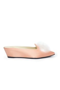 Very clearly something that Alice would wear in Wonderland, these peach  satin slides feature a white pom pom and a short heel and bring the perfect  amount of femininity to your favorite work pantsuit.By Trademark.     * 1.6 in heel     * 68% viscose, 32% Silk     * Leather Sole     * Runs t
