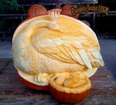 Peacock and baby carved out of pumpkin