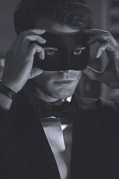 Ready the blindfolds. Fifty Shades of Grey is coming to Digital HD on May 1 and Blu-ray on May 8, and as a little reward, the first image from the sequel, Fifty Shades Darker, has been released. It's a seductive black-and-white picture of Christian Grey (Jamie Dornan) hiding under a mask.