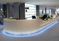 Resultado de imagen de white curved reception desk