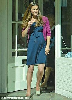 The Duchess of Cambridge looked every inch the glowing mommy to be while out shopping in Chelsea, London. Kate wore a perfect blue summer wrap dress which accentuated her bump, along with a plum cardigan, and her Piede-a-Terre wedges.