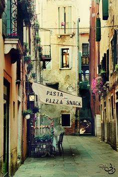 eating pizza in a little restaurant in Roma.