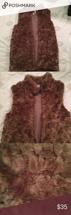 Faux Fur Pink Vest This fur vest is the perfect outer look. The muted pink vest is super soft and extremely stylish. The fur creates its own pattern when the light hits it. The vest comes with pockets and a mock collar. Forever 21 Jackets & Coats Vests