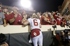 Oklahoma's Baker Mayfield (6) celebrates with fans after the Bedlam college football game between the Oklahoma State Cowboys (OSU) and the Oklahoma Sooners (OU) at Boone Pickens Stadium in Stillwater, Okla., Saturday, Nov. 4, 2017. Oklahoma won 62-52. Photo by Bryan Terry, The Oklahoman