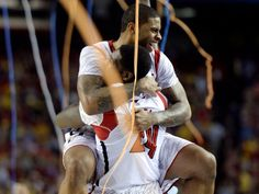 Louisville Cardinals forward Montrezl Harrell celebrates with forward Chane Behanan after the championship game at the Georgia Dome.