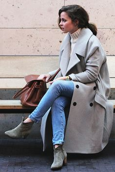 Beige-ish grey ankle boots, cream turtleneck sweater, skinny jeans, long grey coat