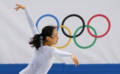 Mao Asada of Japan practices her routine during a figure skating training session at the Iceberg Skating Palace during the 2014 Sochi Winter...