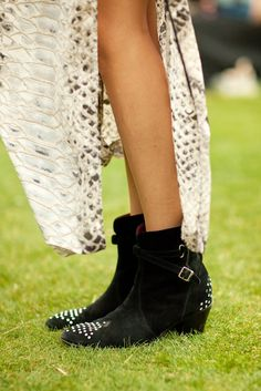 This chica danced for three days straight in her studded Jean Michel Cazabats! Give the lady a medal. Photographed by Mark Iantosca #refinery29 http://www.refinery29.com/music-festival-accessories-pictures#slide-12